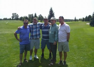 Five golfers on the golf course at Fore for Shan