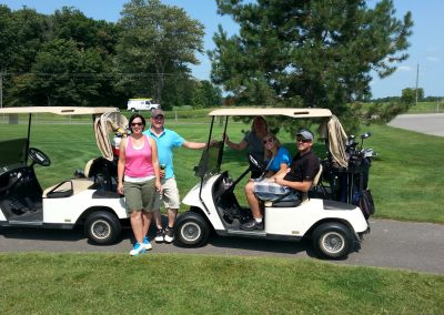 Golfers and their golf carts at Fore for Shan 2014