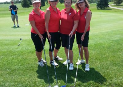 4 Lady golfers in red shirts at Fore for Shan 2014
