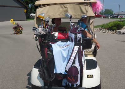 Team Shan shirt on the back of golf cart at Fore for Shan 2014