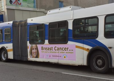 Team Shan graphic on side of UBC bus