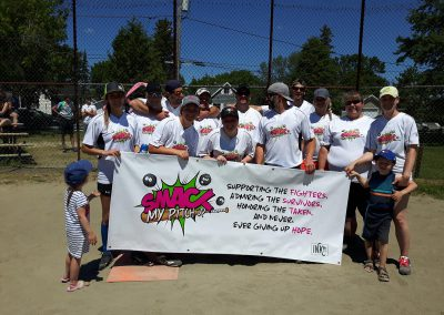 Knock Cancer Out of the Park 2019: InkIt Design and Print baseball team with their sign.